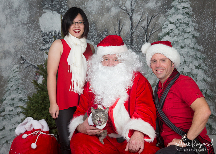 Woman man and cat with santa