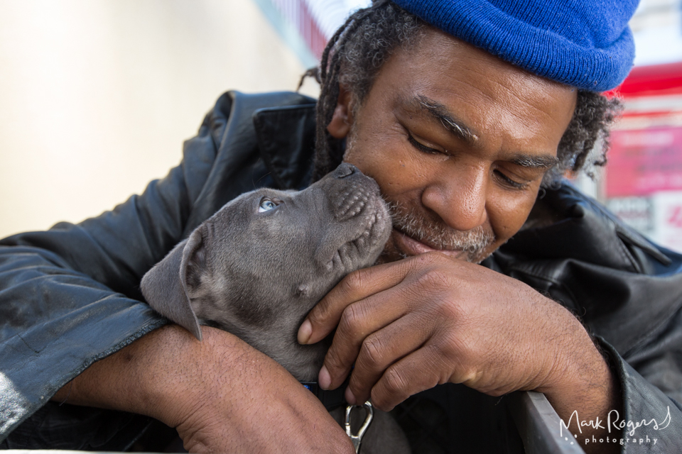 homeless man with his pit bull puppy
